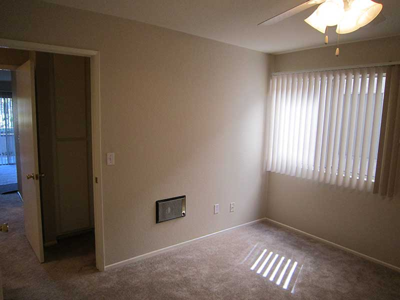 Window and Ceiling Fan in Bedroom